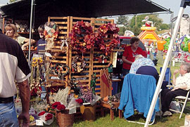 Large arts and crafts displays, great food concessions, and tons of fun at the Apple Stir Fall Harvest Festival at MacQueen Apple Orchard, Cider Mill, Farm Market, and Pick Your Own Apples, Holland, Ohio, west of Toledo